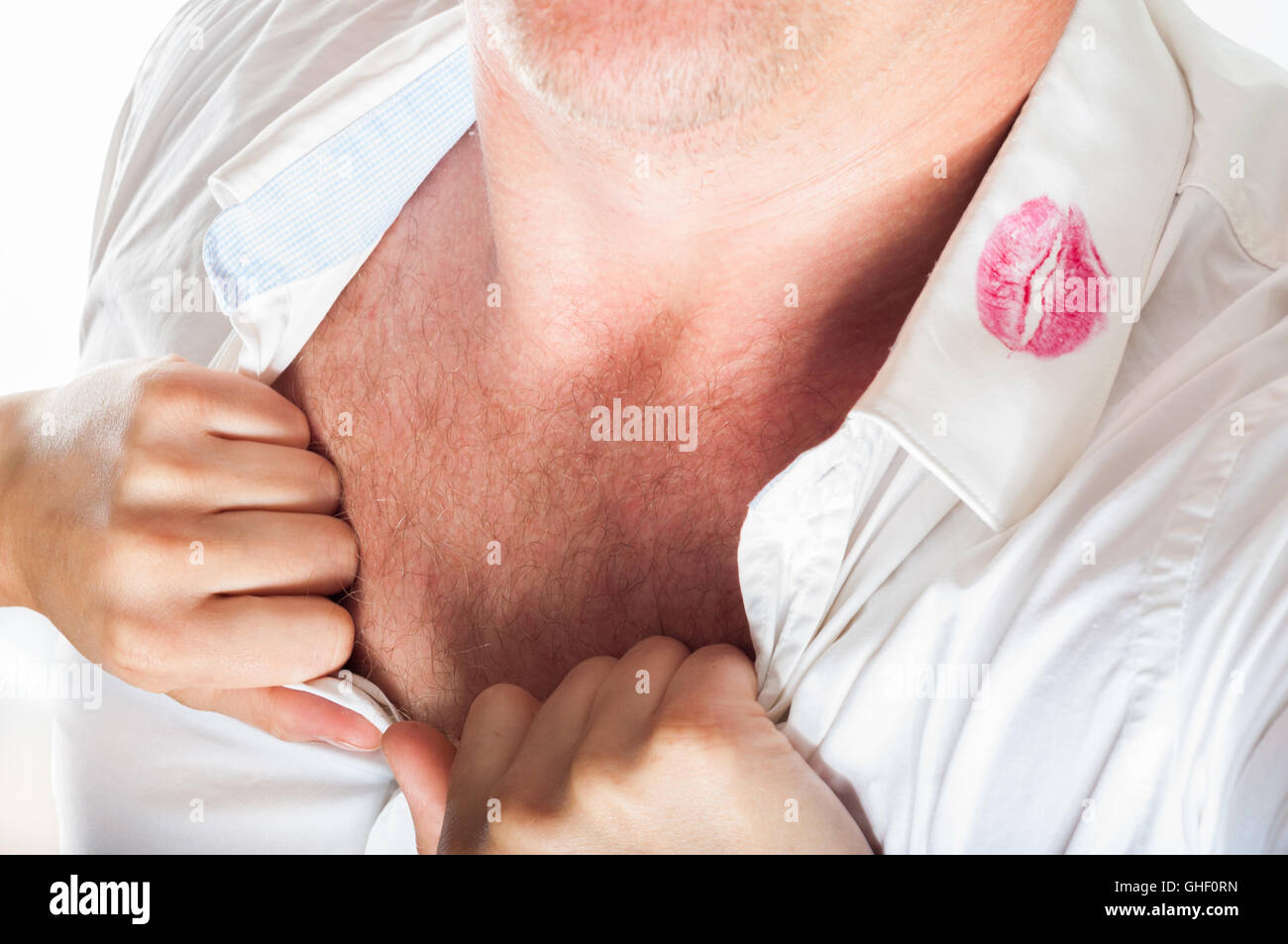 red lipstick on a shirt - Stock Image