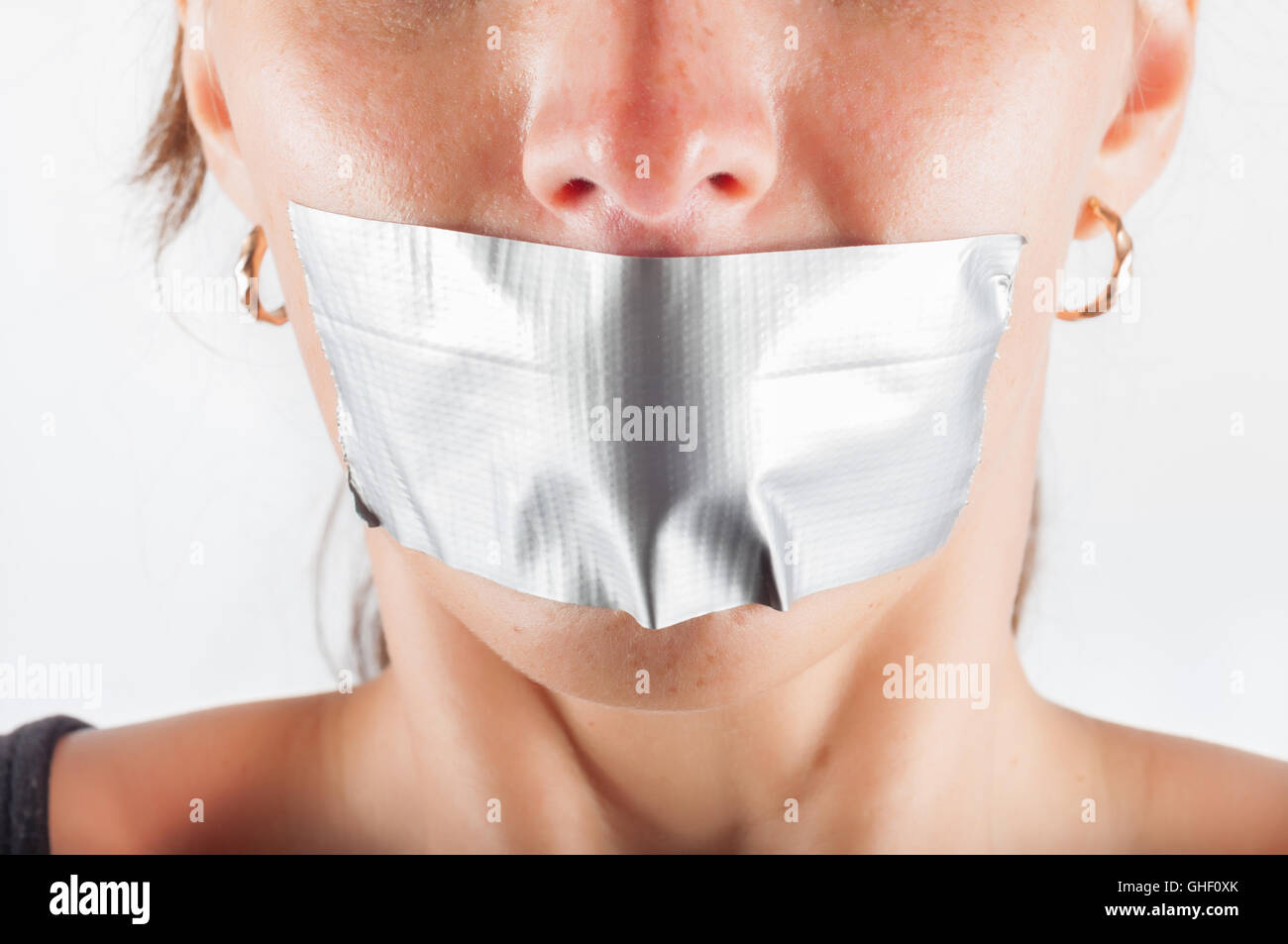 abducted woman with sealed mouth Stock Photo