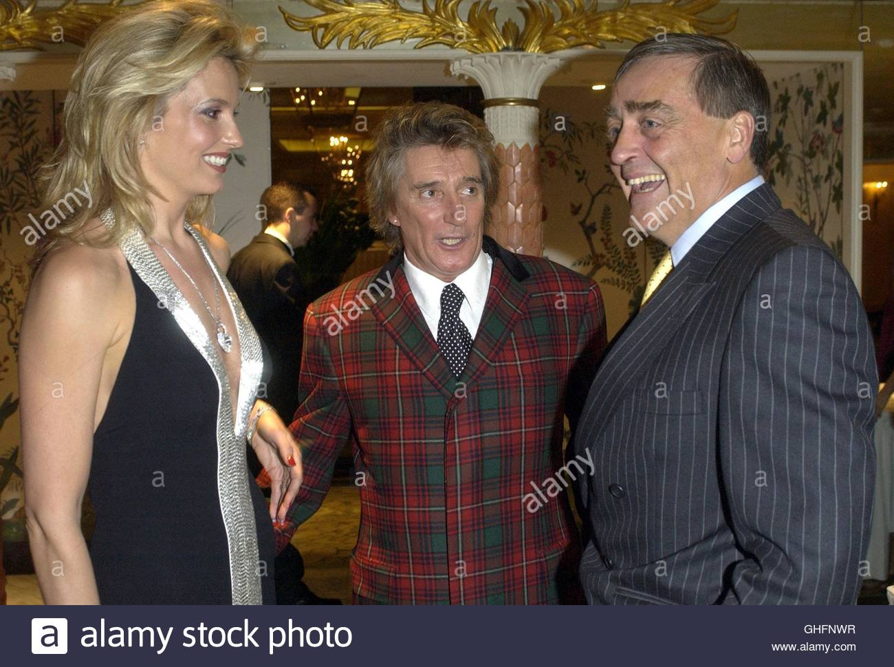 File photo dated 12/10/2004 of Penny Lancaster and Rod Stewart meeting the Duke of Westminster at the Royal National - Stock Image