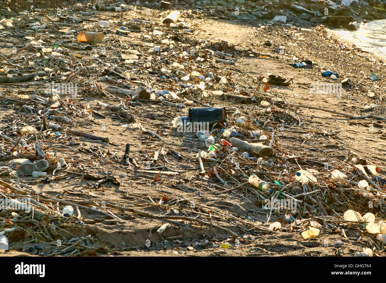 View of garbage mostly plastic bottles on a waterway in the industrial area of New Jersey - Stock Image