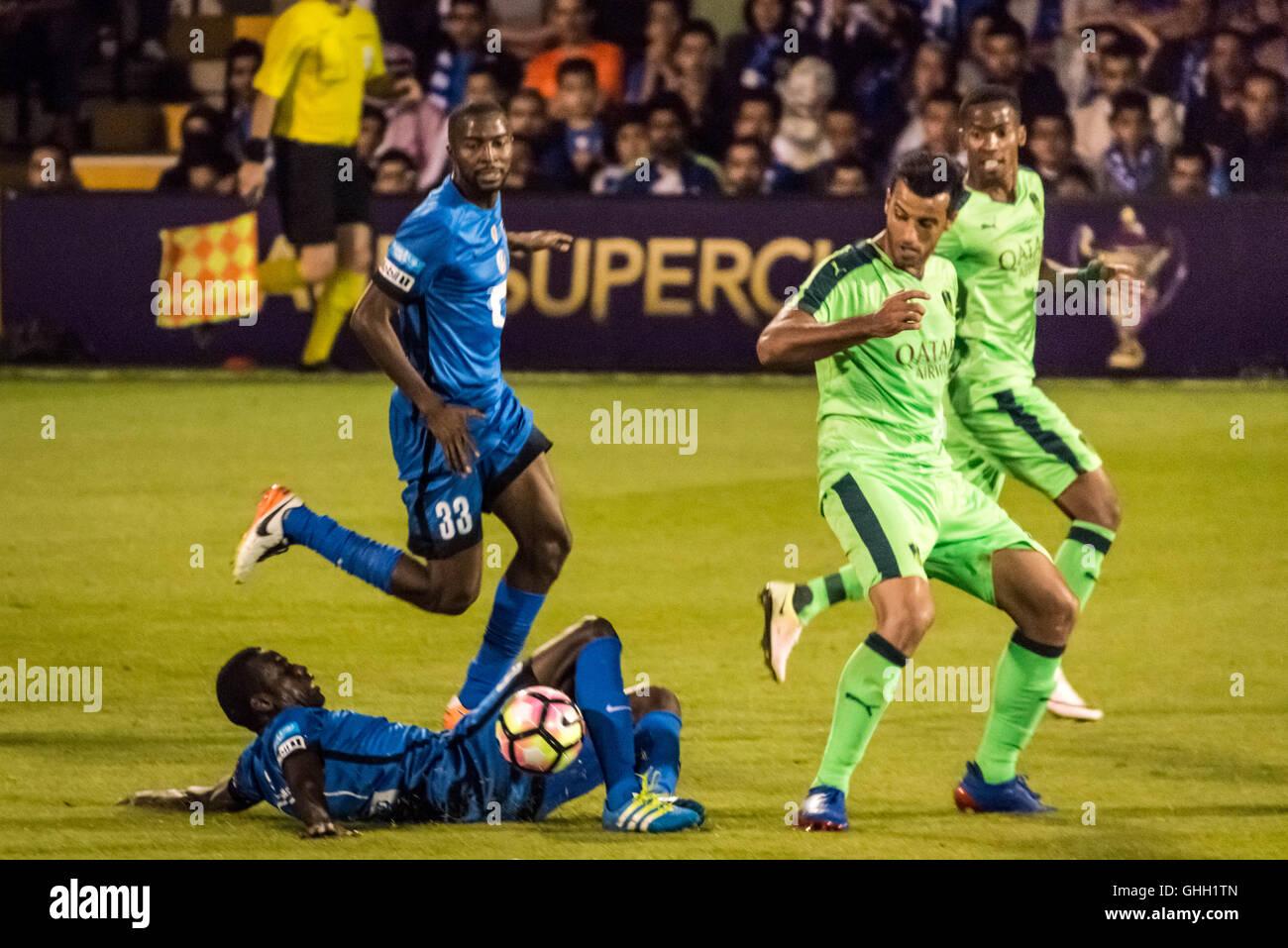 London, UK. 8th August, 2016. Abdulmalek Al-Khaibri #6 (ground), Osama Hawsawi (#33). Al-Ahli vs Al-Hilal Saudi - Stock Image