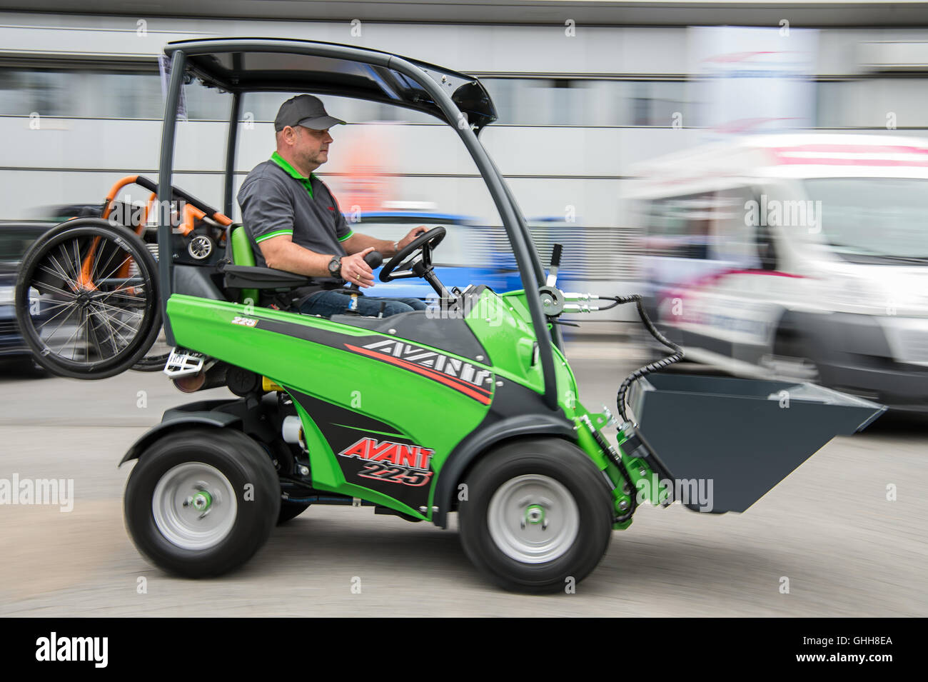 Duesseldorf, Germany. 28th Sep, 2016. Bert Pein driving a 'Handicap-Version' of the multi-fuctional forklift 'AVANT 225' by the Finish company 'Avant Tecno OY' during the opening of the international care fair 'Rheacare' in Duesseldorf, Germany, 28 September 2016. The fair runs until 1 October 2016. PHOTO: WOLFRAM KASTL/dpa/Alamy Live News Stock Photo