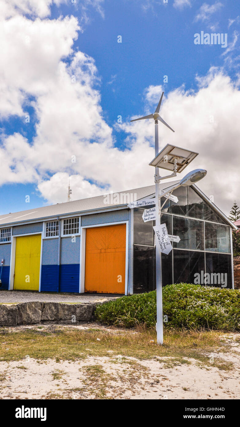 The colorful J-shed arts building with two-tone blue exterior and colorful warehouse doors in Fremantle, Western - Stock Image