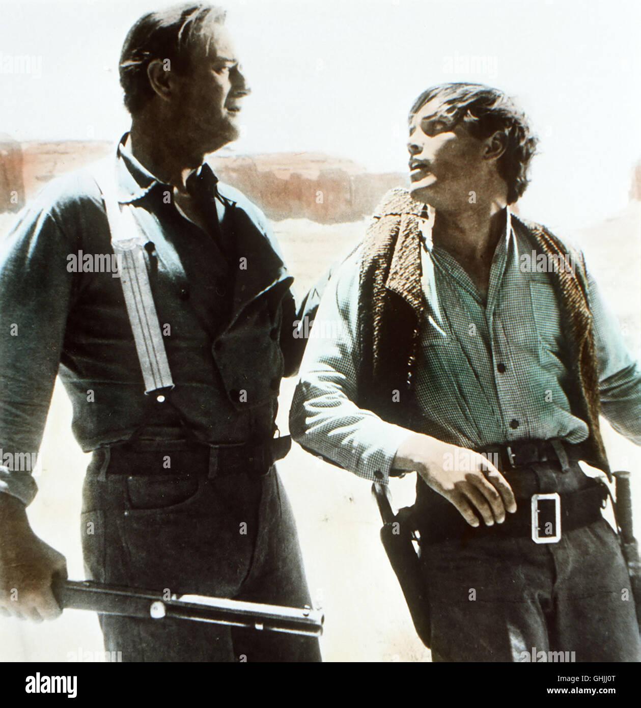 The Searchers USA 1956 - John Ford Als Ethan Edwards (JOHN WAYNE) erfährt, dass seine Nichte Debbie, die vor - Stock Image