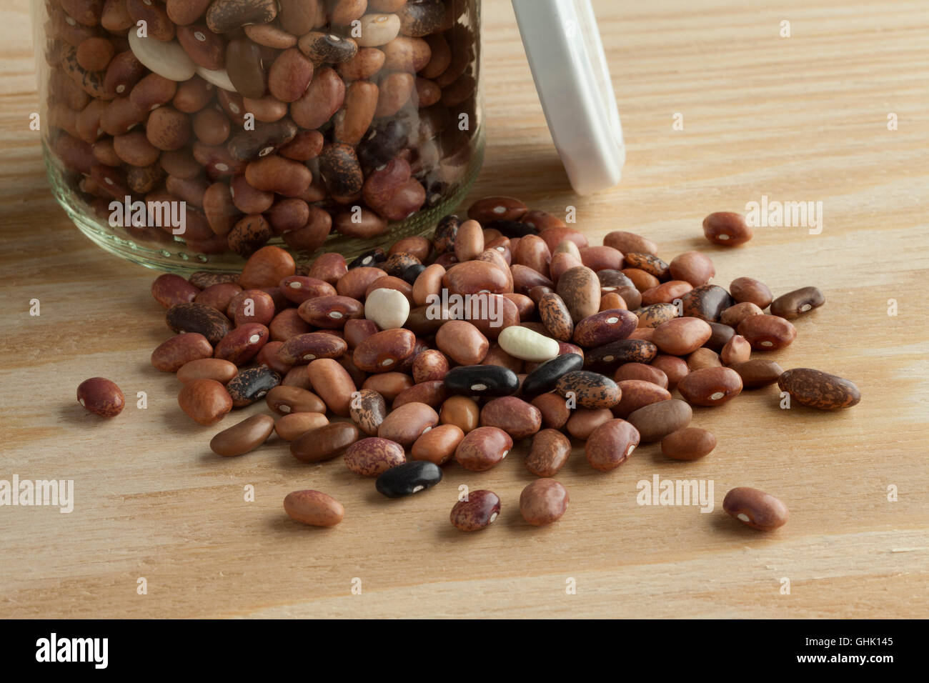Glass jar with pebble beans close up - Stock Image