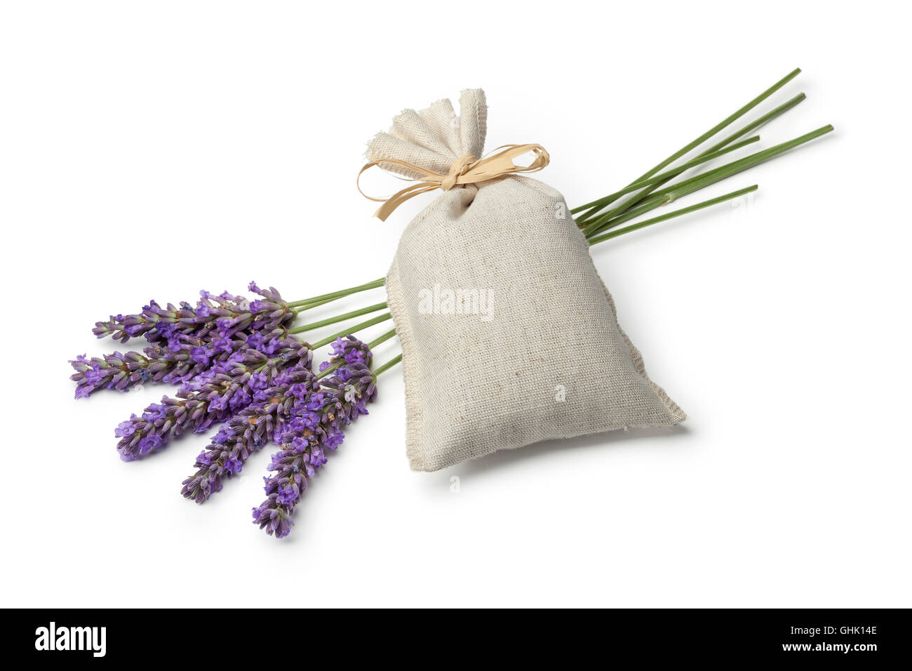 Linen sack with dried lavender flowers and fresh lavender on white background - Stock Image