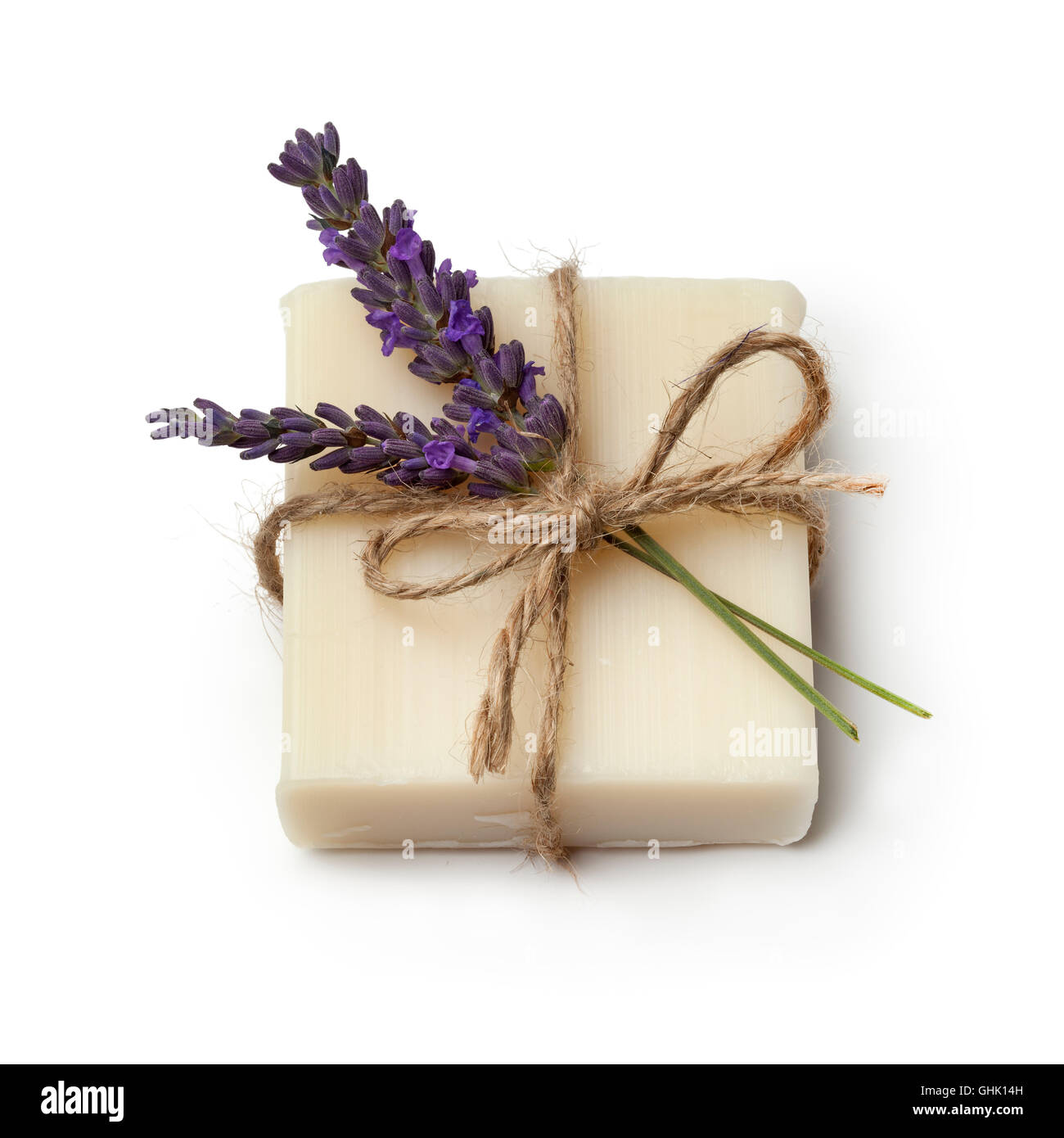 Piece of lavender soap and fresh lavender on white background - Stock Image