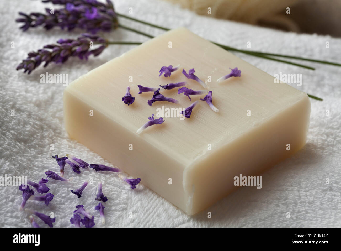 Bar of lavender soap and flowers - Stock Image