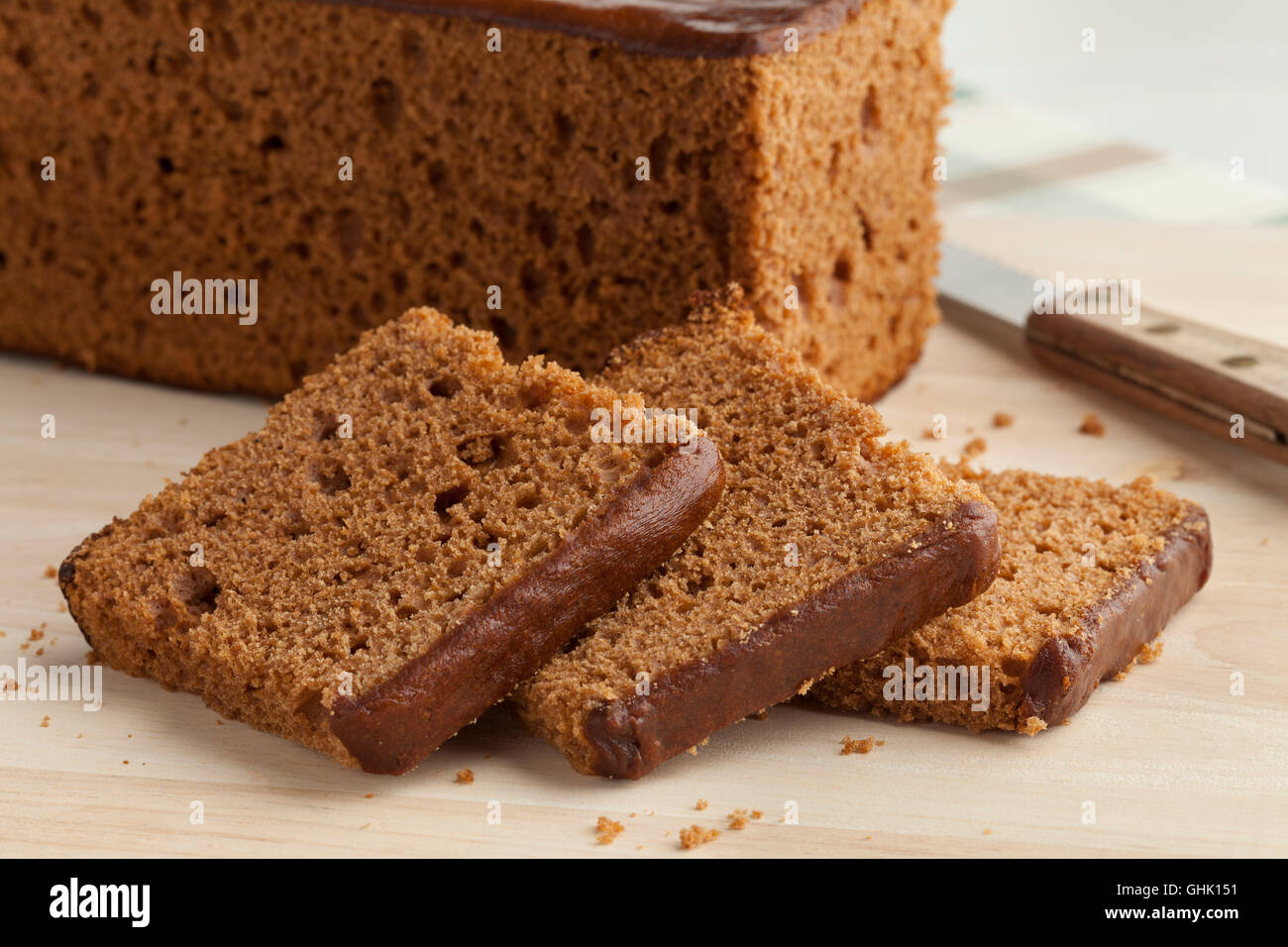 Traditional dutch breakfast cake cut into slices - Stock Image