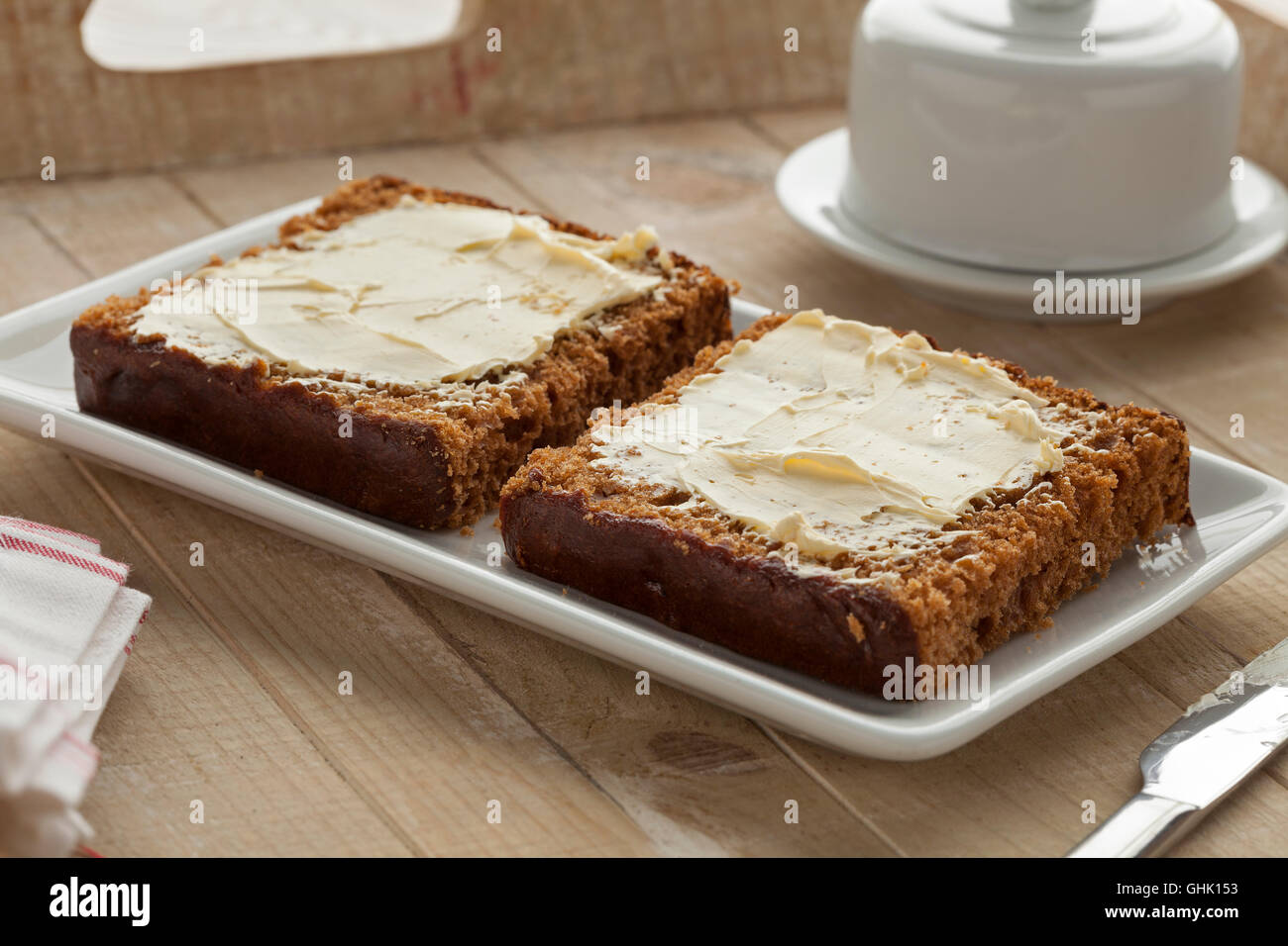 Traditional dutch breakfast cake with butter - Stock Image