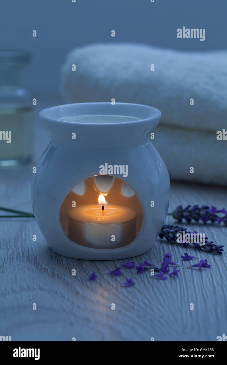 Candle for aroma therapy with lavender oil - Stock Image