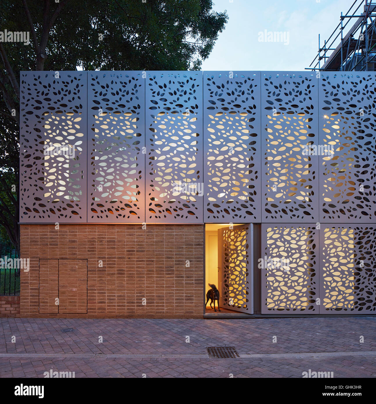 Front elevation of entrance facade with metal screen at for Minimalist house brixton