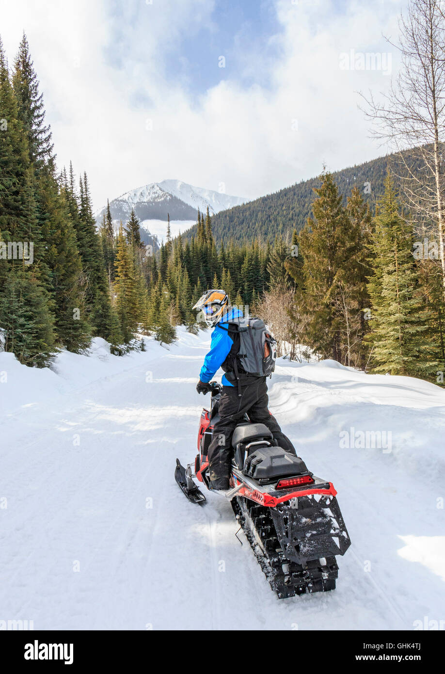 Having fun while snowmobiling in the Purcell Mountains near Golden, BC - Stock Image