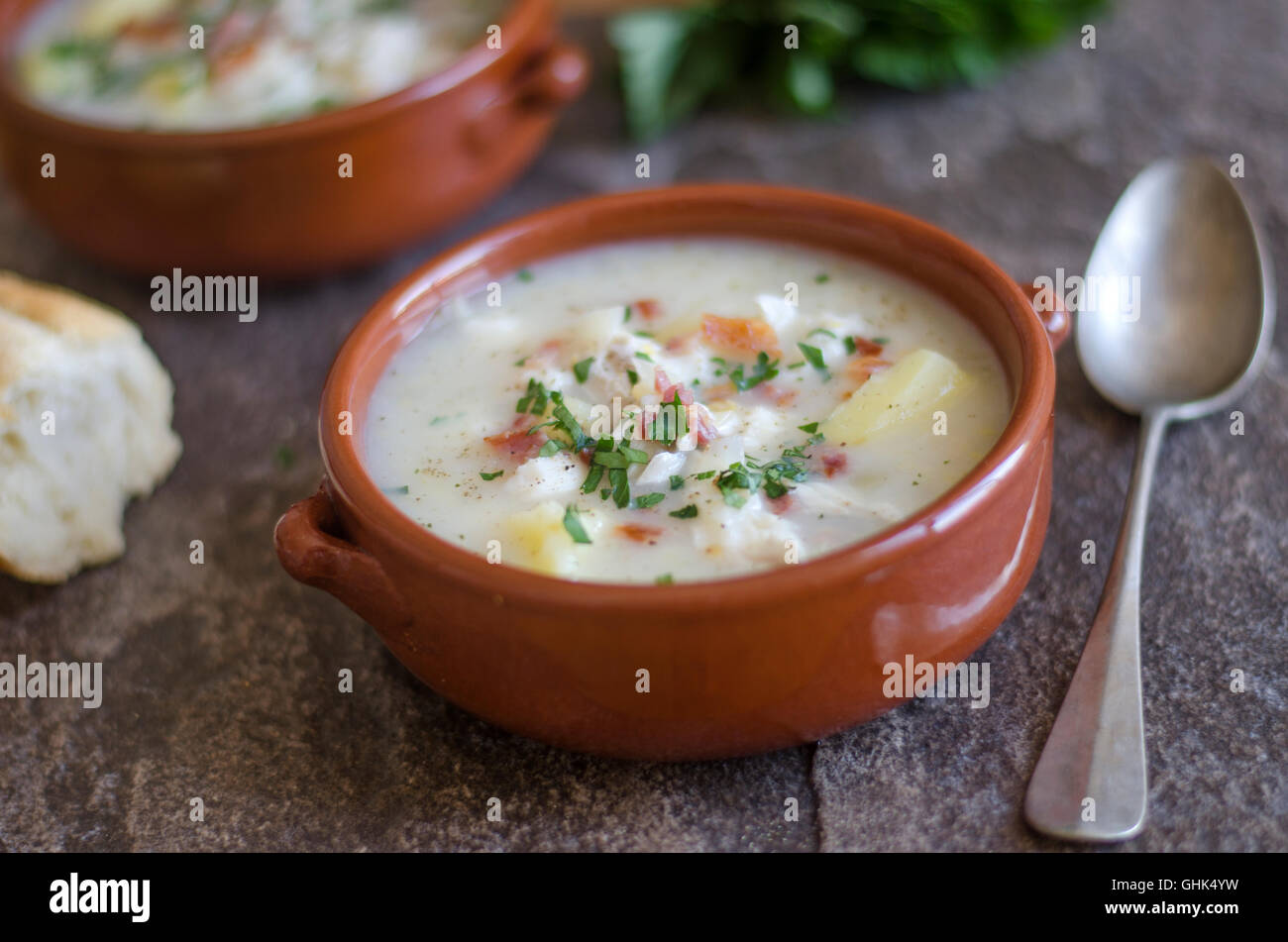 Smoked haddock chowder topped with crispy bacon - Stock Image