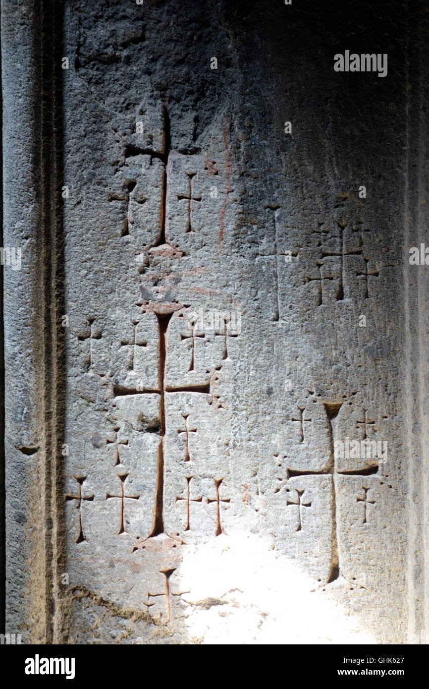 Geghard monastic complex Armenia UNESCO site repeated crosses on wall Christian motifs - Stock Image