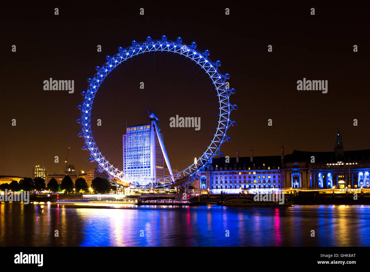 The London Eye on the South Bank of the River Thames at night. At a height of 135 meters, London Eye is the tallest - Stock Image