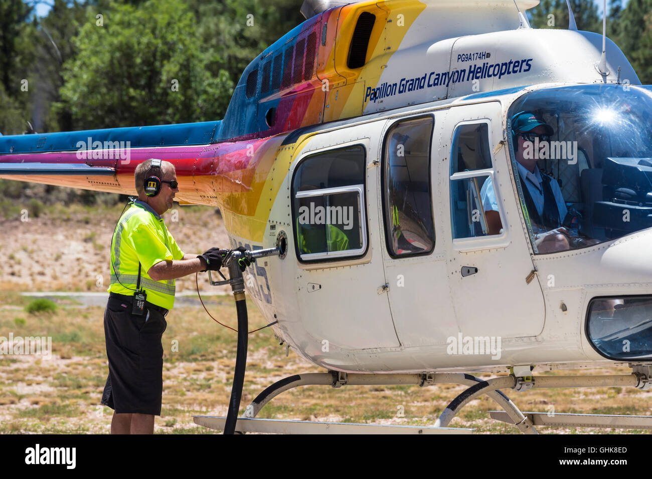 Tusayan, Arizona - A worker fuels a sightseeing helicopter at Grand Canyon National Park Airport. - Stock Image