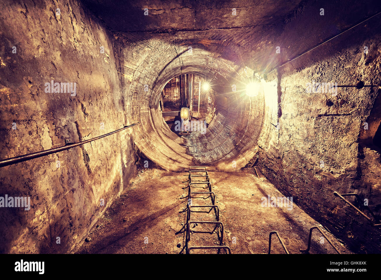 Retro toned old abandoned coal mine ventilation tunnel, industrial background. - Stock Image