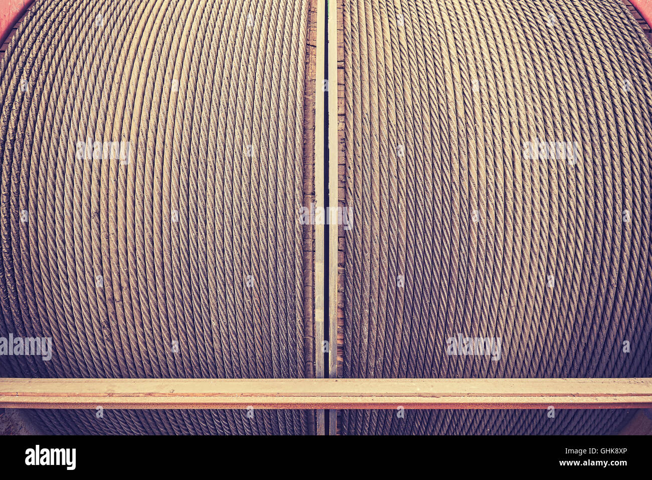 Vintage toned steel winching cable, industrial background. - Stock Image