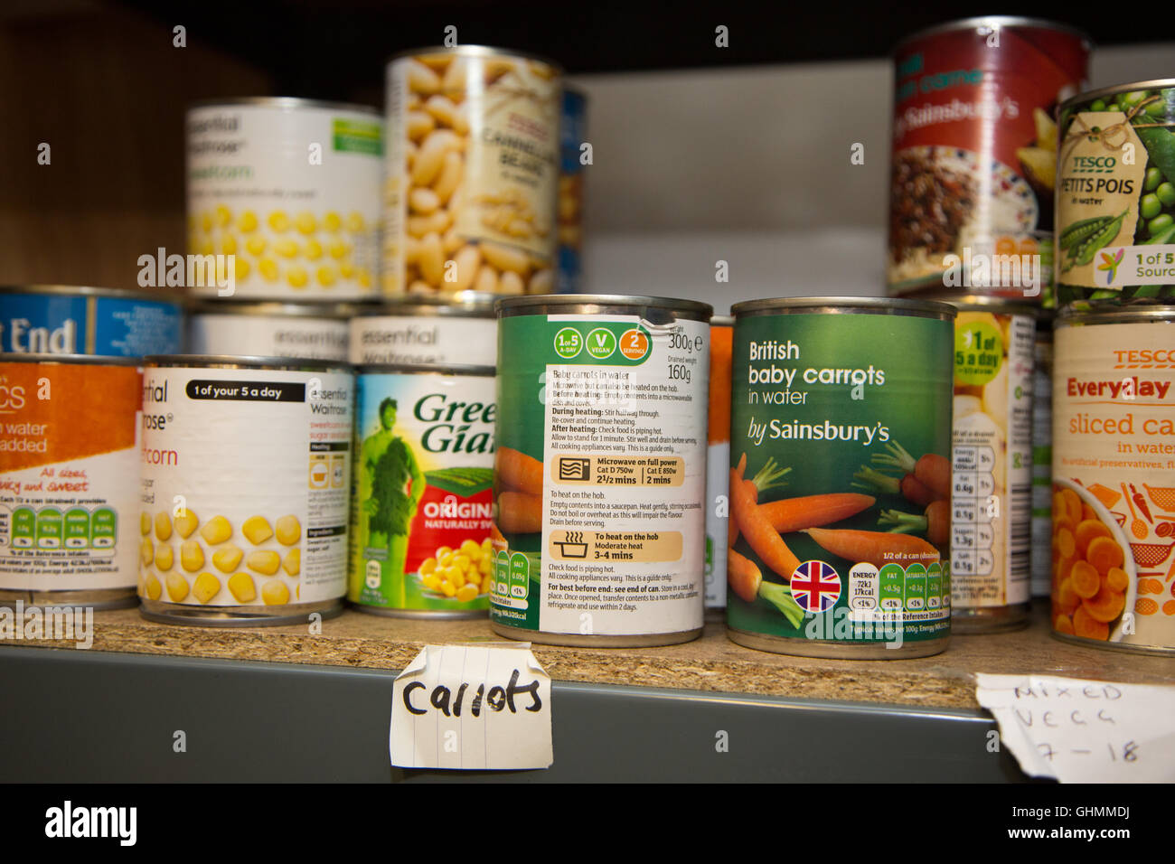 Cans of vegetables and beans in a foodbank - Stock Image