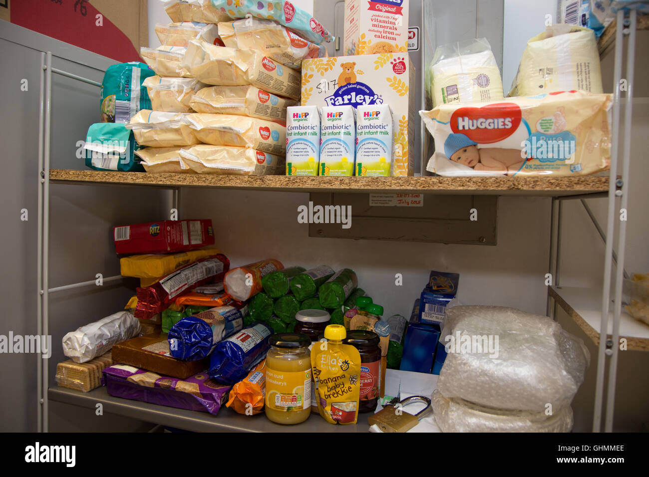 Shelves at North Paddington foodbank, which includes baby products, biscuits, crackers. - Stock Image