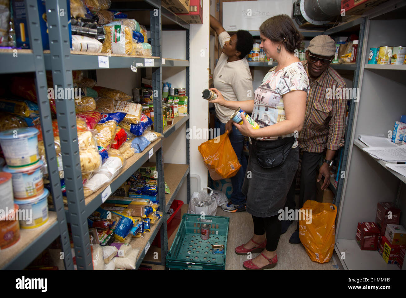 Volunteers stock shelves at North Paddington foodbank. - Stock Image
