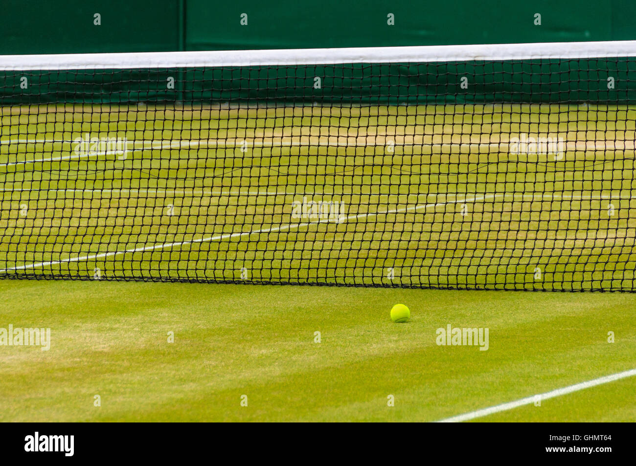 Tennis ball on a lawn tennis court - Stock Image