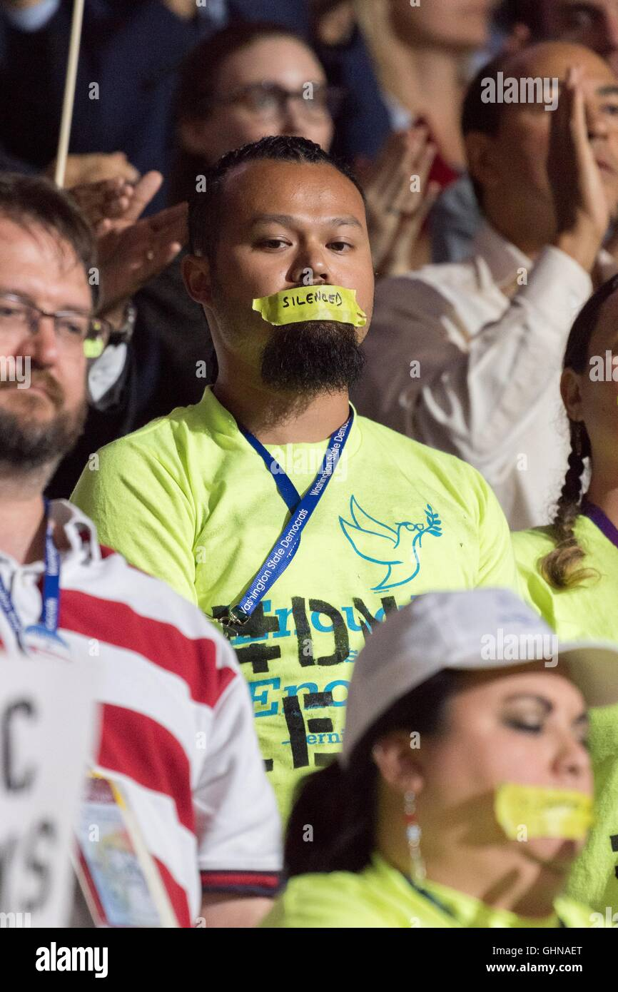 Bernie Sanders supporters protest by wearing gags over their mouth during speeches on the final day of the Democratic - Stock Image