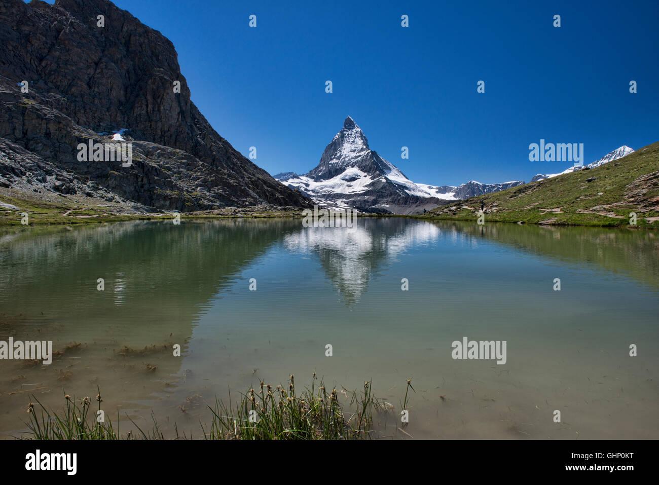 The Matterhorn reflected in the Riffelsee Lake, Zermatt, Switzerland - Stock Image