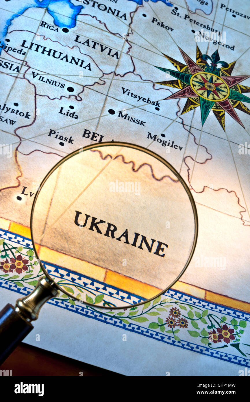 Old style map with magnifying glass over Ukraine featuring Latvia Lithuania Minsk & Eastern Europe - Stock Image