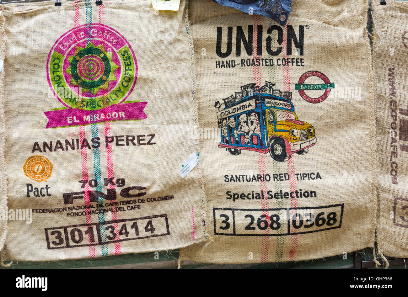 Close up of Coffee sacks for sale on market stall off Brick Lane, London in July - Stock Image