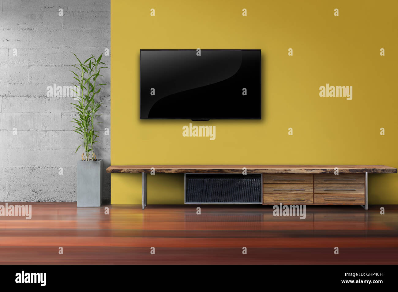 Living room led tv on yellow wall with wooden table and plant in pot ...