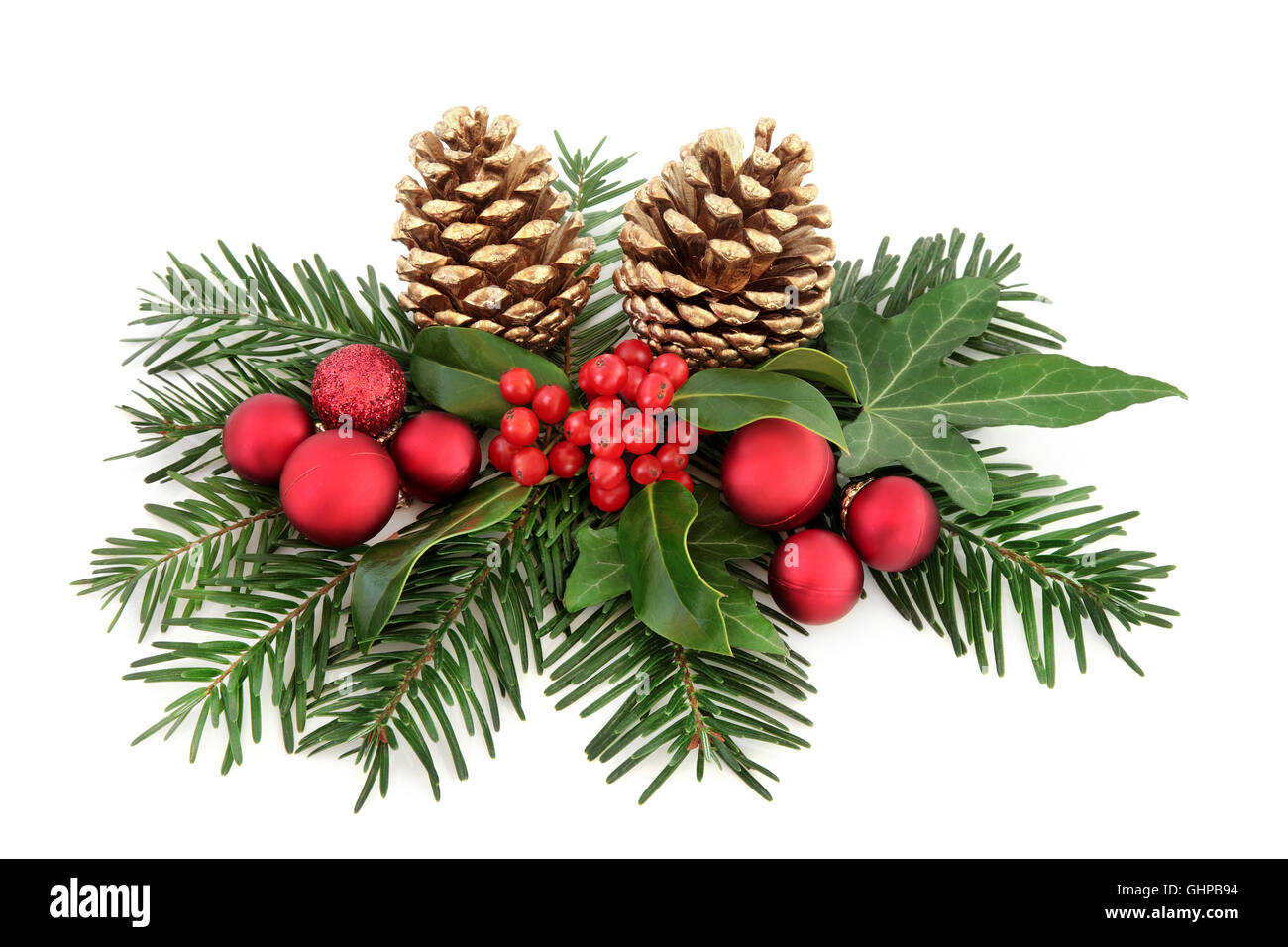 2d88a13b5ac3 Christmas decoration with red baubles, holly, ivy, gold pine cones and  winter greenery over white background.