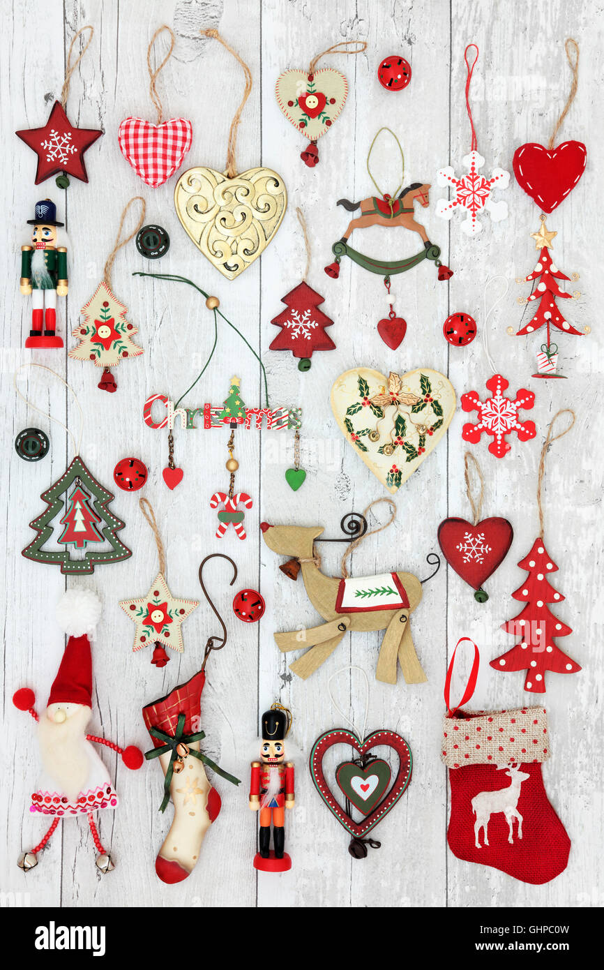 Old fashioned christmas tree decorations and baubles over distressed ...