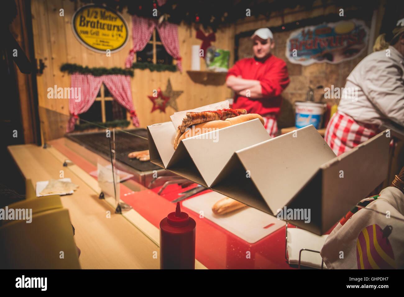 Germany traditional Bratwurst stall at Berliner Weihnachtsmarkt. - Stock Image