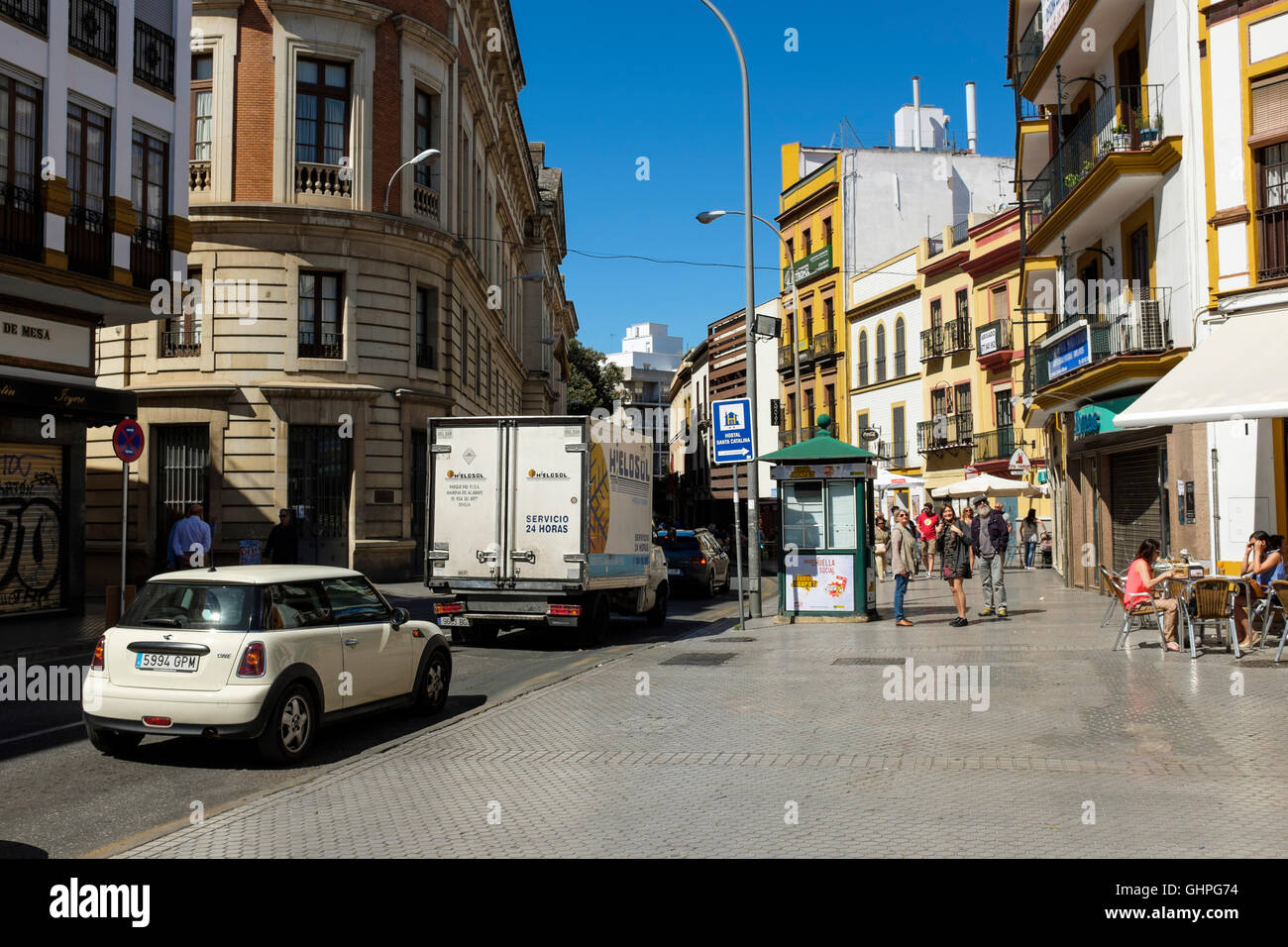 Busy traffic on Calle Almirante Apodaca, in the Al Macarena district of Seville, Spain. - Stock Image
