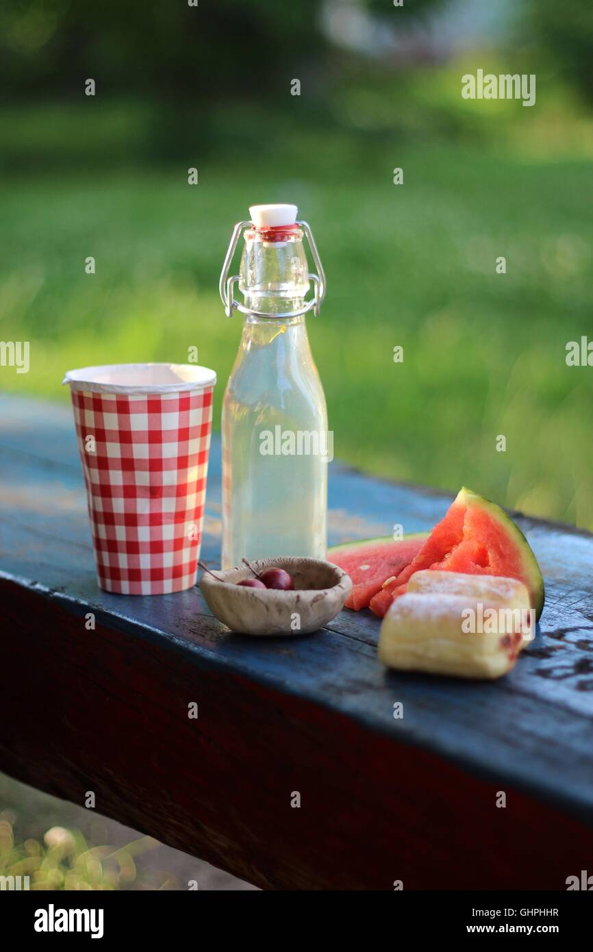 Summer picnic on the bench in the park Stock Photo