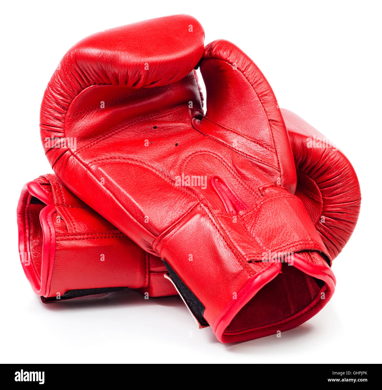 Pair of red leather boxing gloves isolated on white background - Stock Image