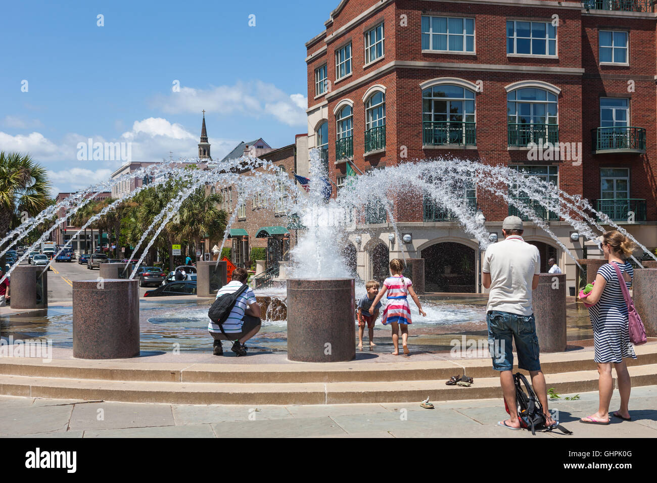 People enjoy one of the fountains in Waterfront Park in Charleston, South Carolina. - Stock Image