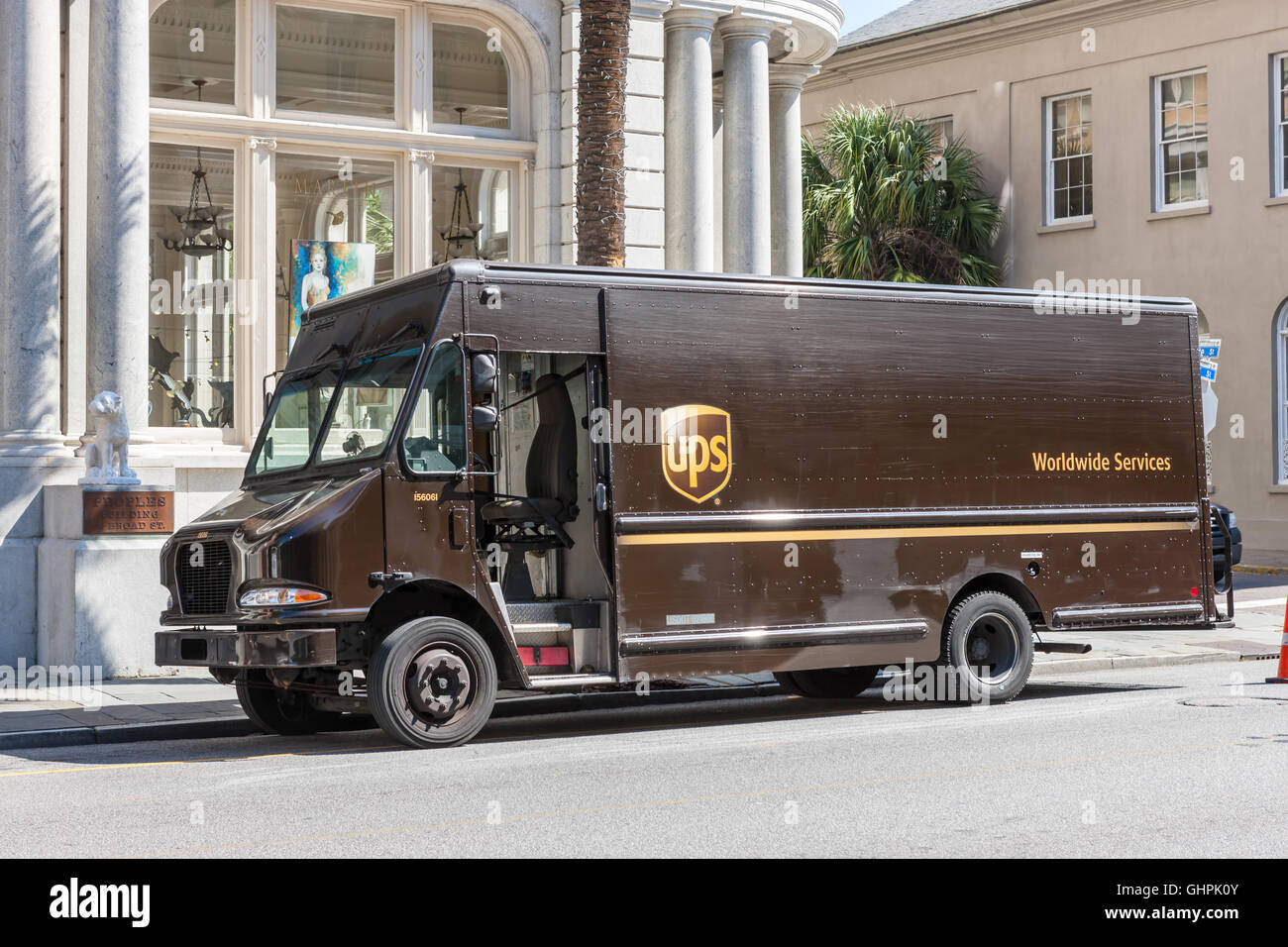 A UPS truck makes a local delivery in Charleston, South Carolina. - Stock Image