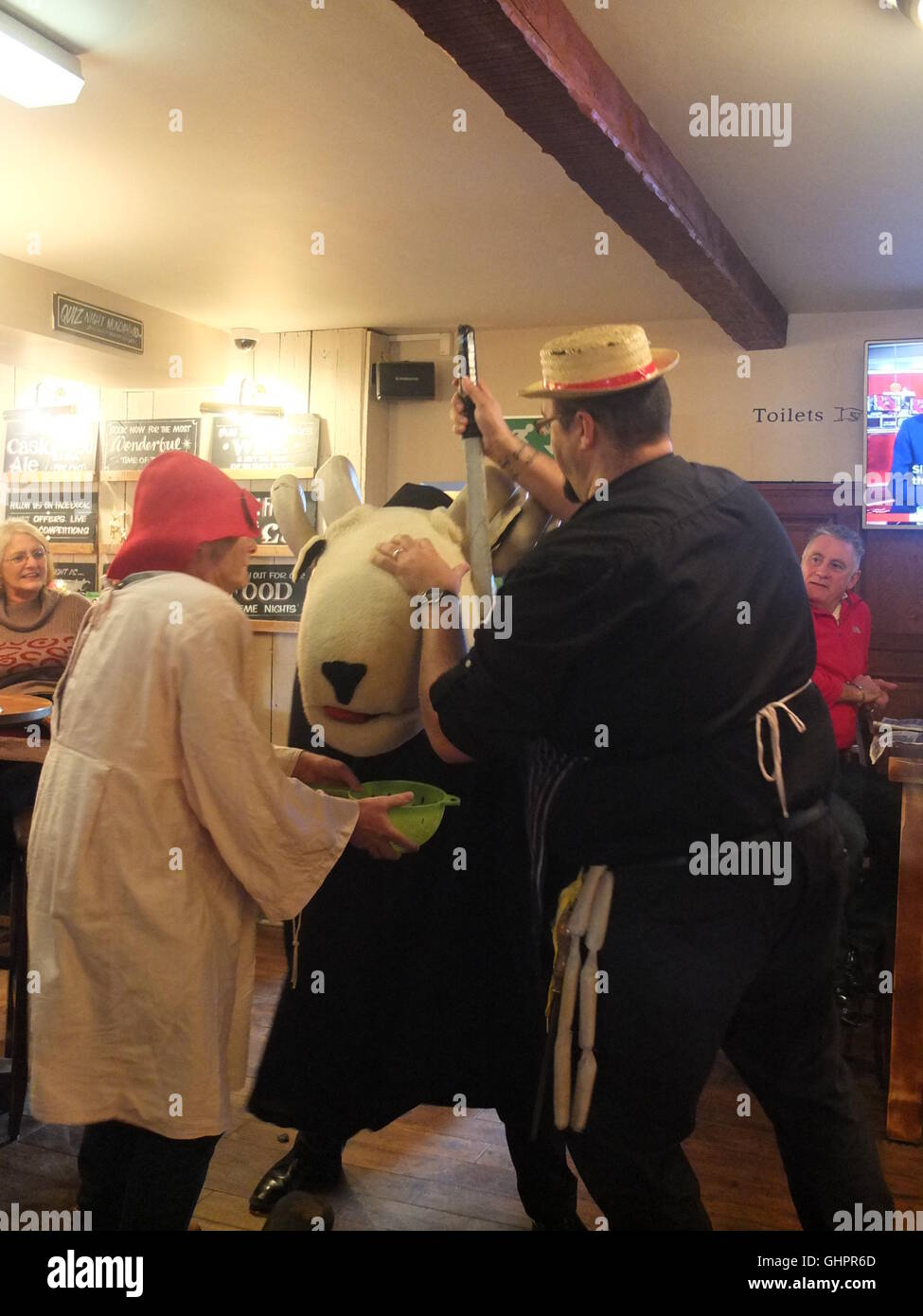 Harthill Morris perform the traditional mummers play The Derby Tup at the Phoenix Inn, Ridgeway. Slaughter of Tup. - Stock Image