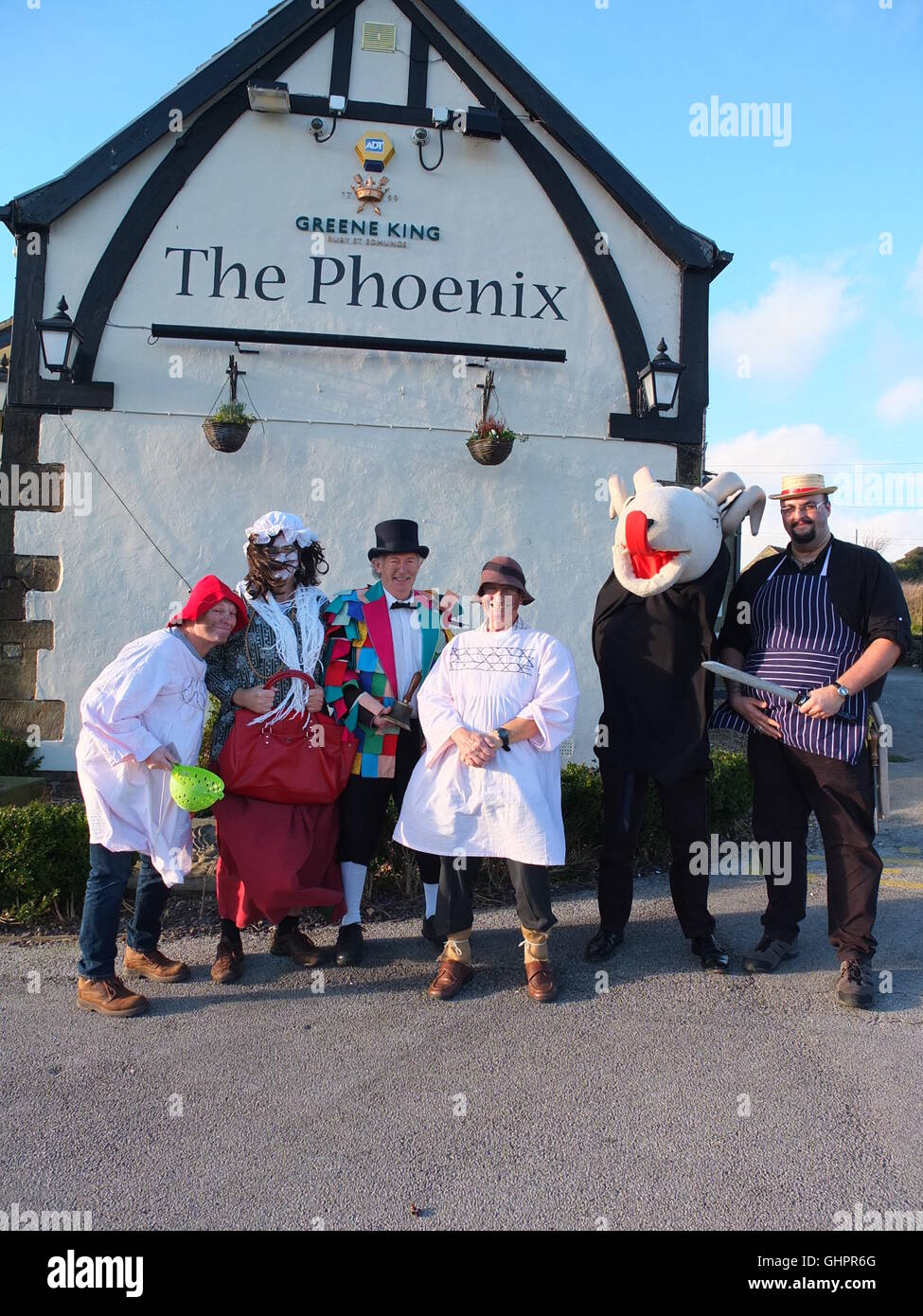 Harthill Morris team after performing the traditional mummers play The Derby Tup at the Phoenix Inn, Ridgeway - Stock Image