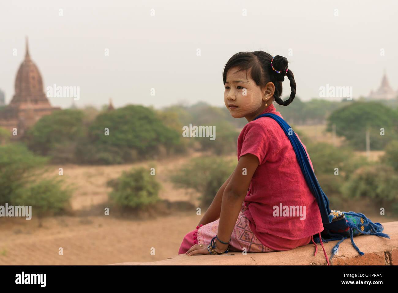 Asia, Burmese girls sat looking very hopeful. - Stock Image