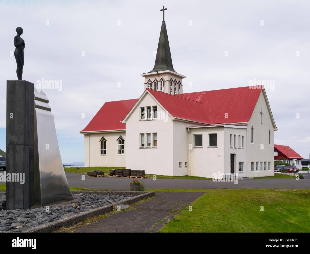 Grundarfjörður church opened 1961Snæfellsnes peninsula Iceland Syn sculpture in the foreground - Stock Image