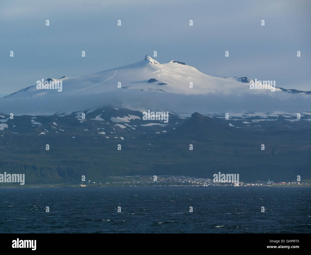 View to Snæfellsjökull  700000-year-old stratovolcano with a glacier covering top from Flaxafloi Bay on - Stock Image