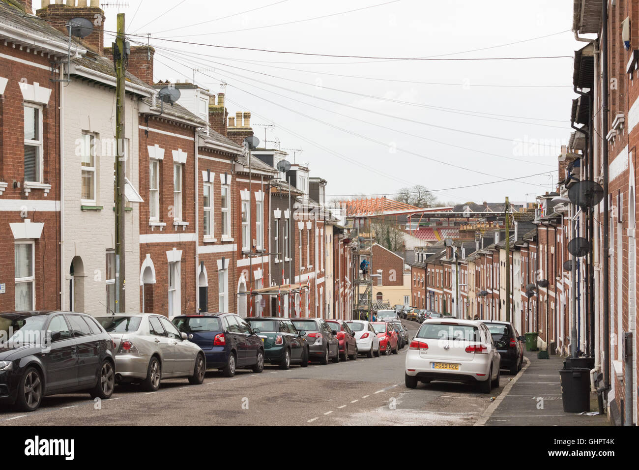 Residential terraced housing including student flats and houses leading down to St James Park football ground, Exeter, - Stock Image