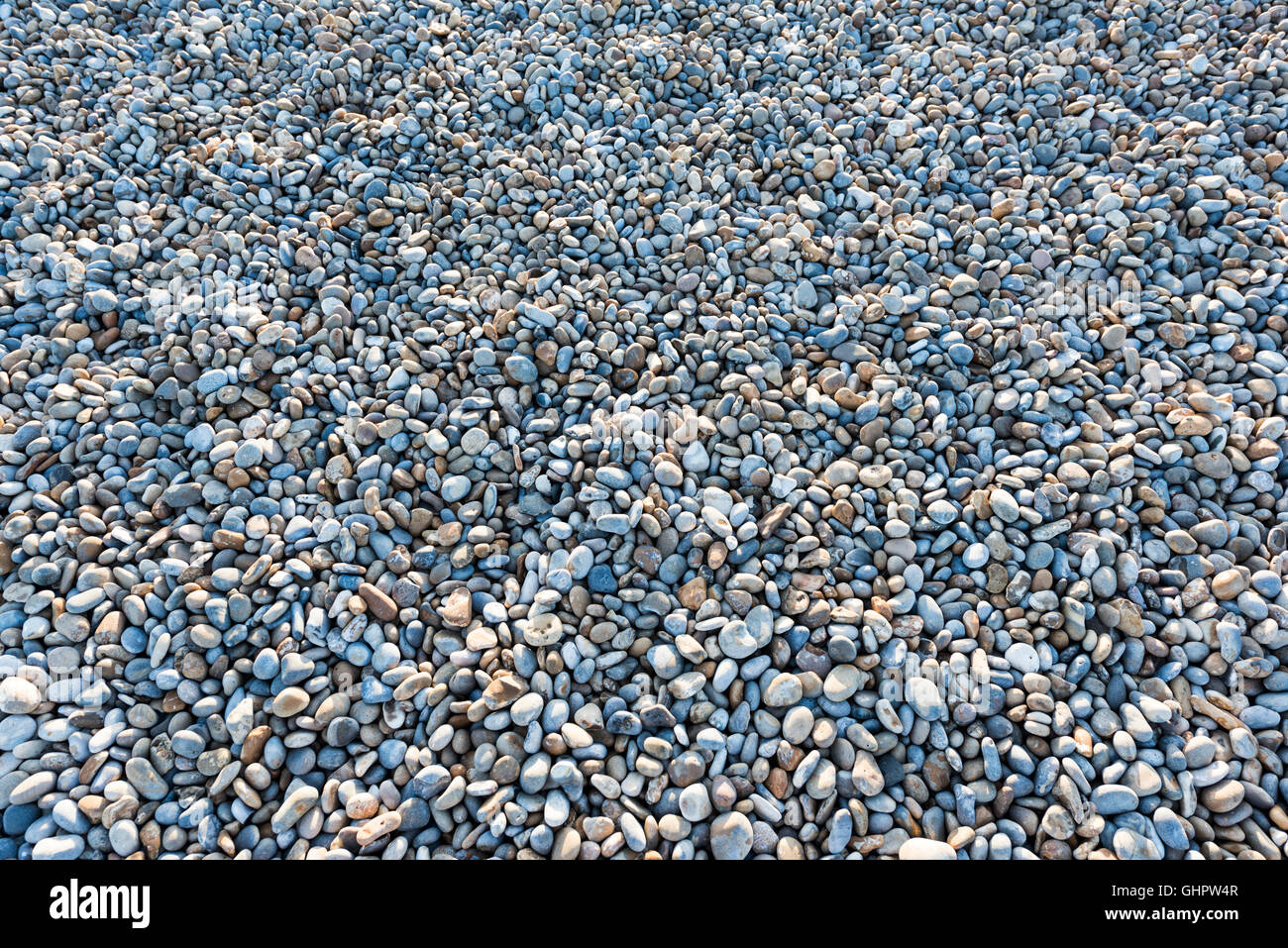 Close up abstract photo of a shingle beach. Could be used a texture background. - Stock Image