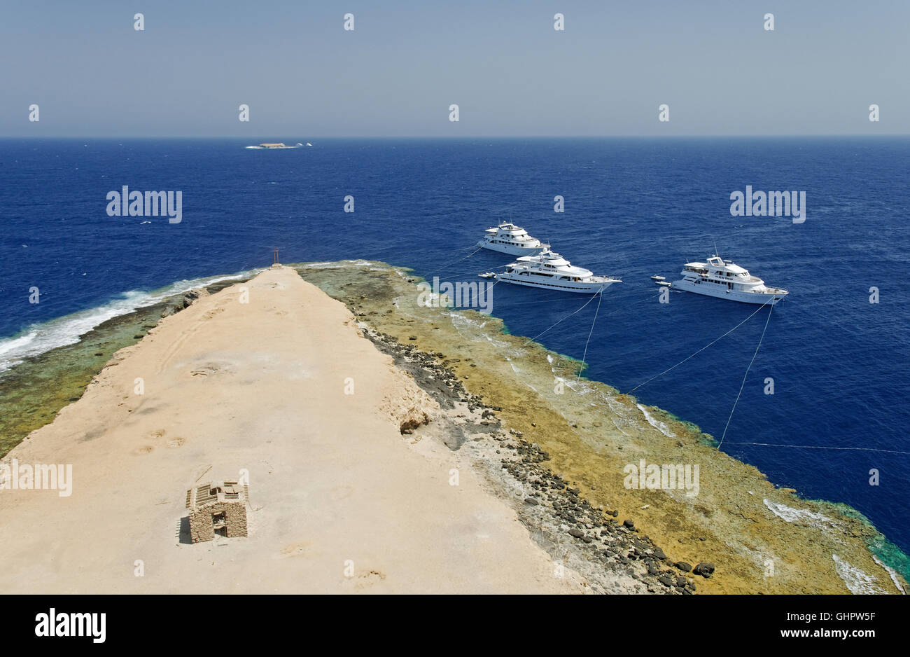 View from lighthouse of the Big brother to the sea and Littele Brother and liveaboard boats, Brother Islands, Red - Stock Image