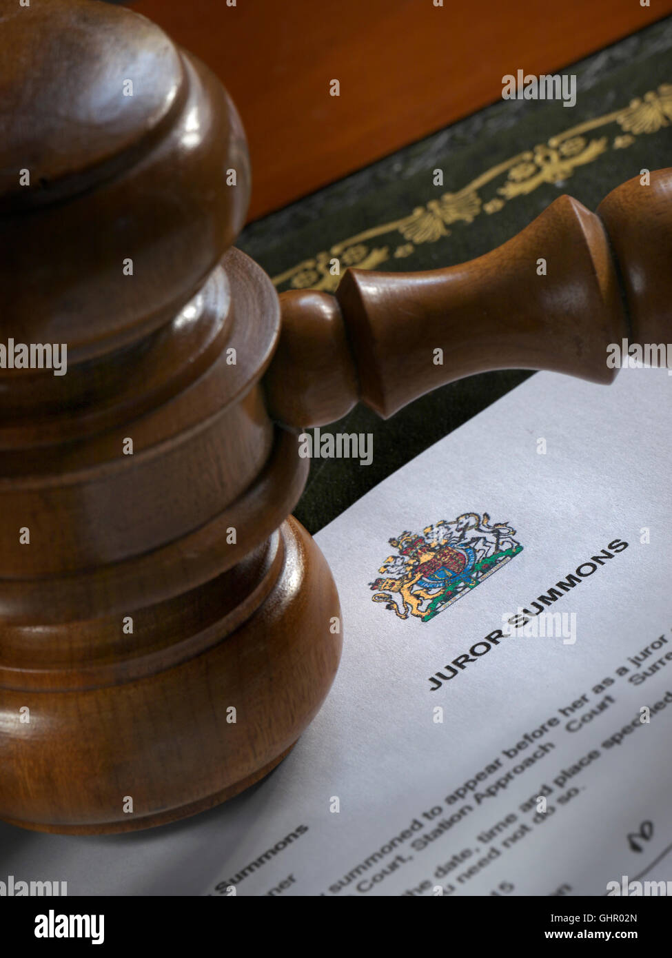 Legal concept with Judges Gavel on Juror Summons letter - Stock Image