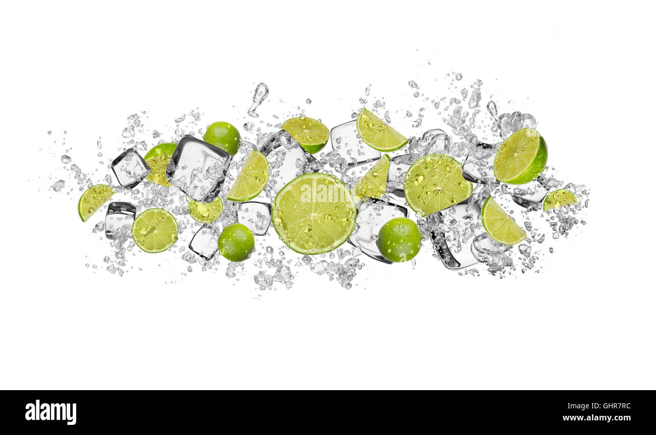 Pieces of limes in water splash and ice cubes, isolated on white background - Stock Image